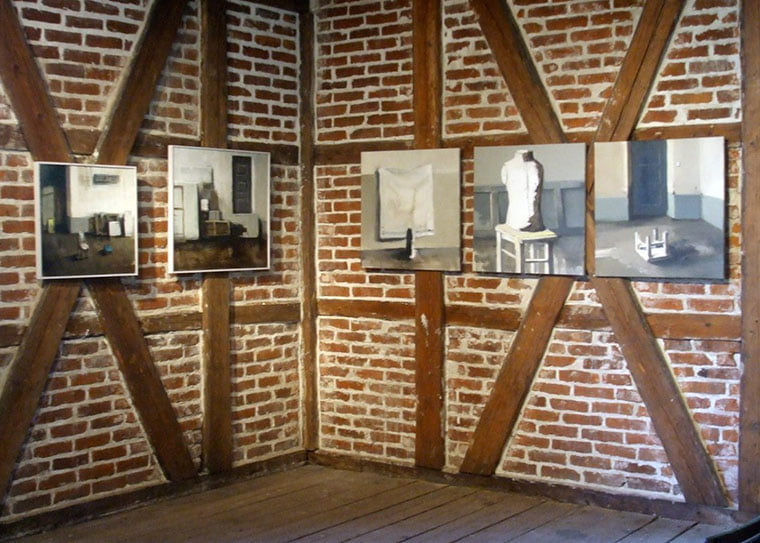 A temporary exhibition inside a beautiful timber-frame building on Hovedøya island near Oslo