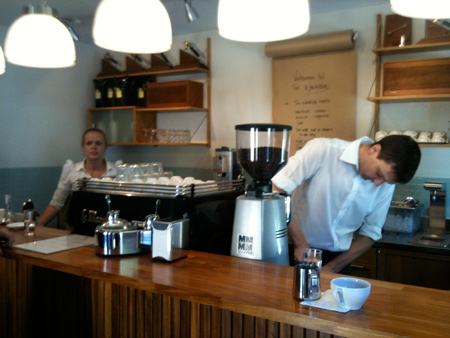 Tim Windelboe and a barista behind the counter