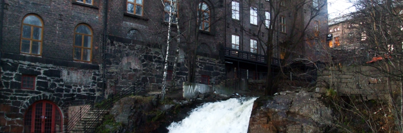 Akerselva in Oslo tumbling past factory buildings