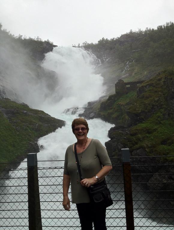 Mum in front of the Kjosfossen waterfall