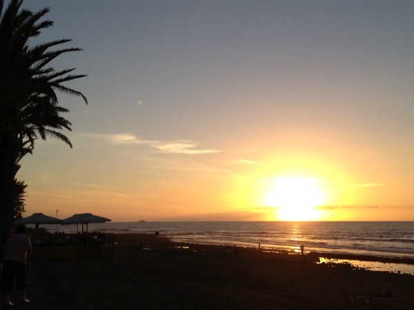 The sun setting over Playa de las Americas
