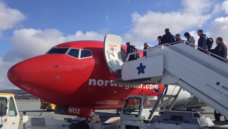 Passengers boarding a Norwegian flight