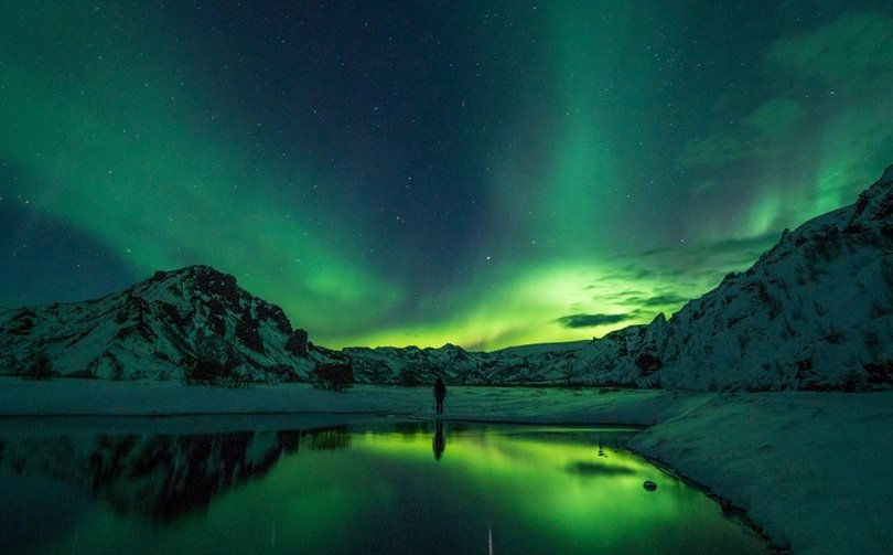 A bright green aurora borealis display in Norway