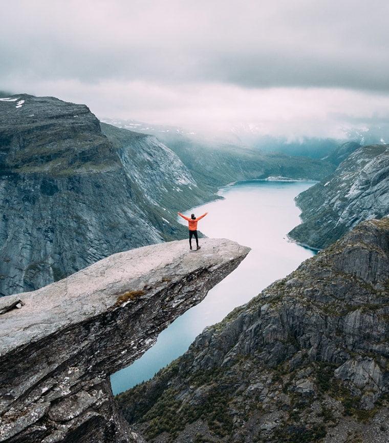 Standing on Trolltunga in Norway