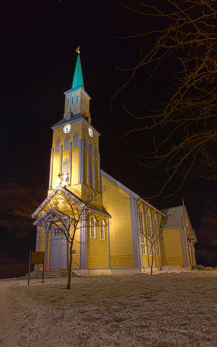 The wooden cathedral of Tromsø at night