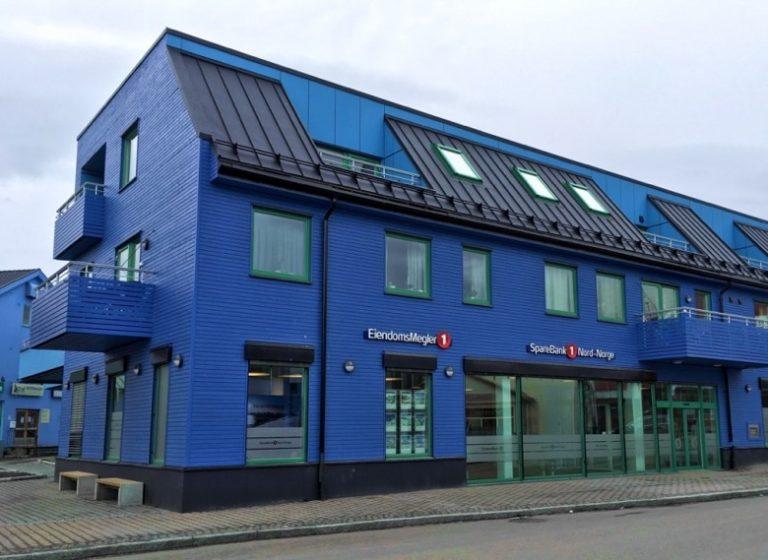 A blue bank building in Sortland, Norway
