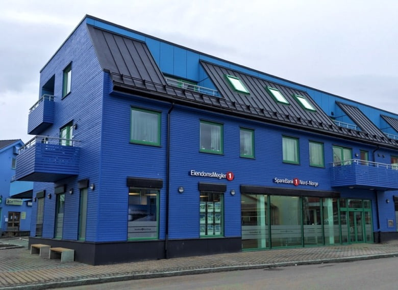A blue bank building in Sortland, Norway