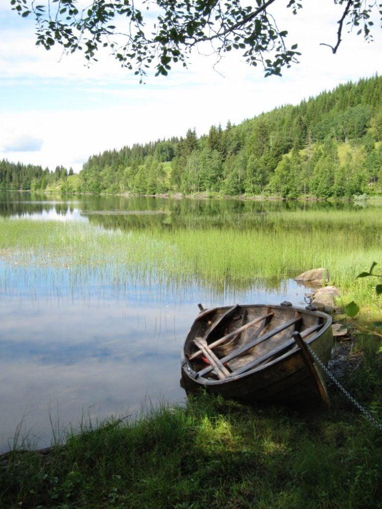 Hiking past a Norwegian lake