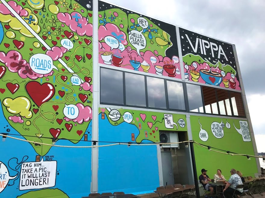 Brightly coloured murals on the exterior of Vippa, Oslo's latest food hall.