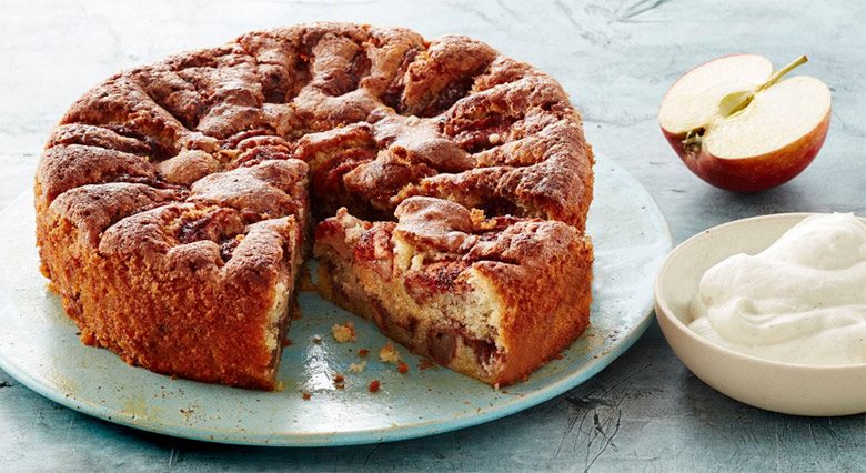 Traditional Norwegian apple cake served with cream.