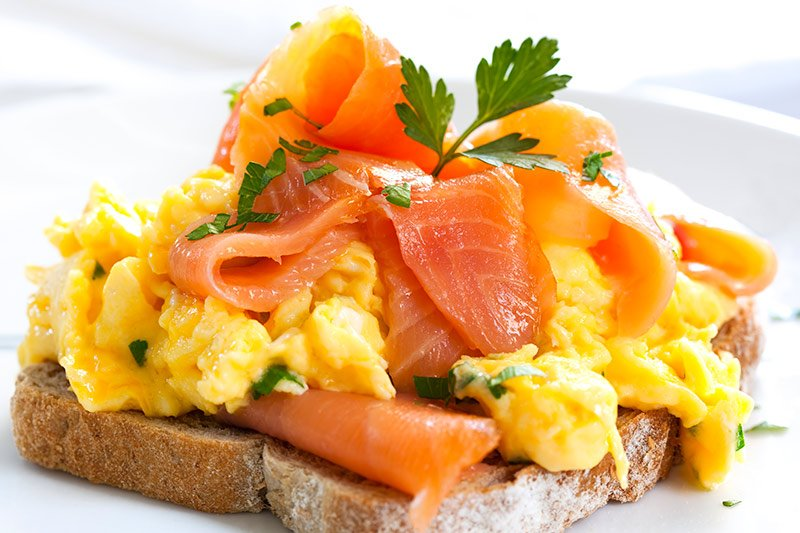 A scrambled egg and smoked salmon sandwich