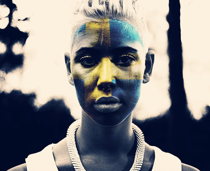 The Swedish flag face-painted on a young woman.