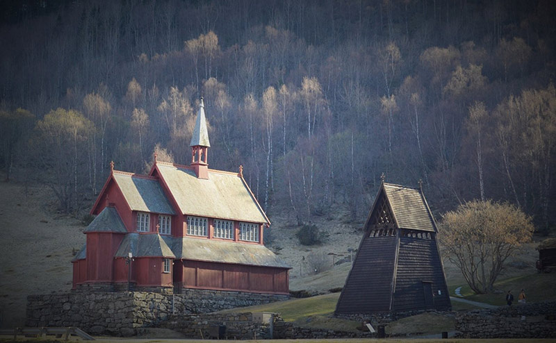 The newer church standing adjacent to Borgund stave church in Norway