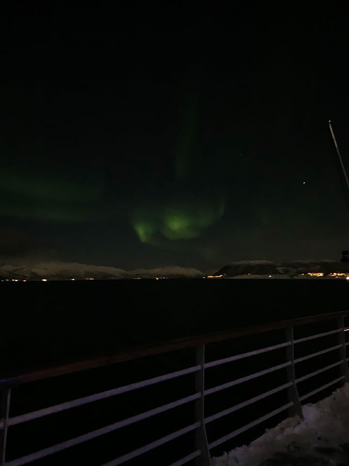 Watching the aurora borealis dance from the deck of the Hurtigruten ship MS Vesterålen