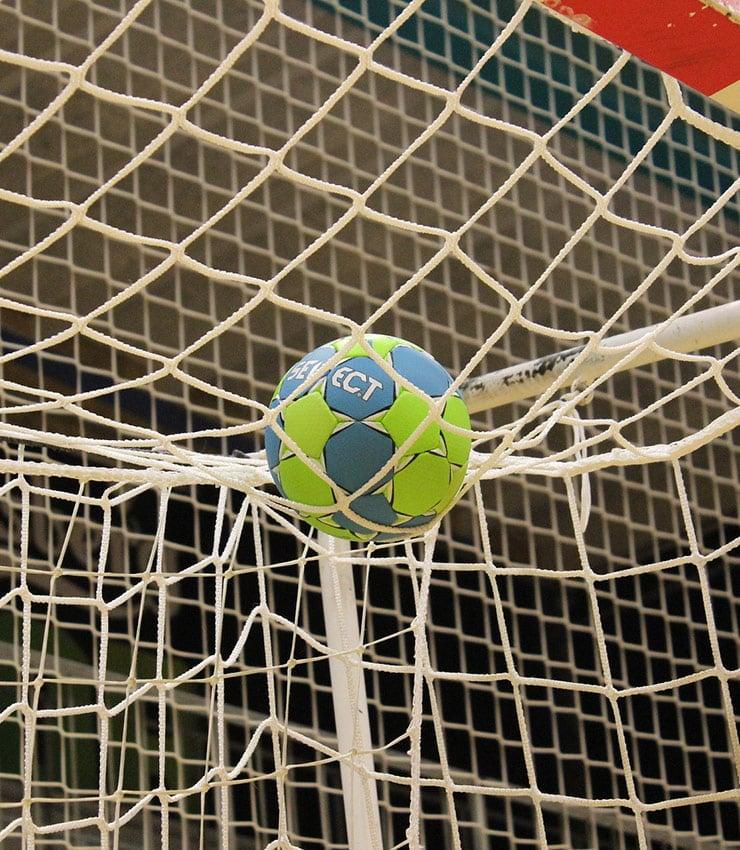 A handball ball in the net