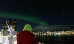 Northern lights visible from the Hurtigruten quay in Tromsø, Norway