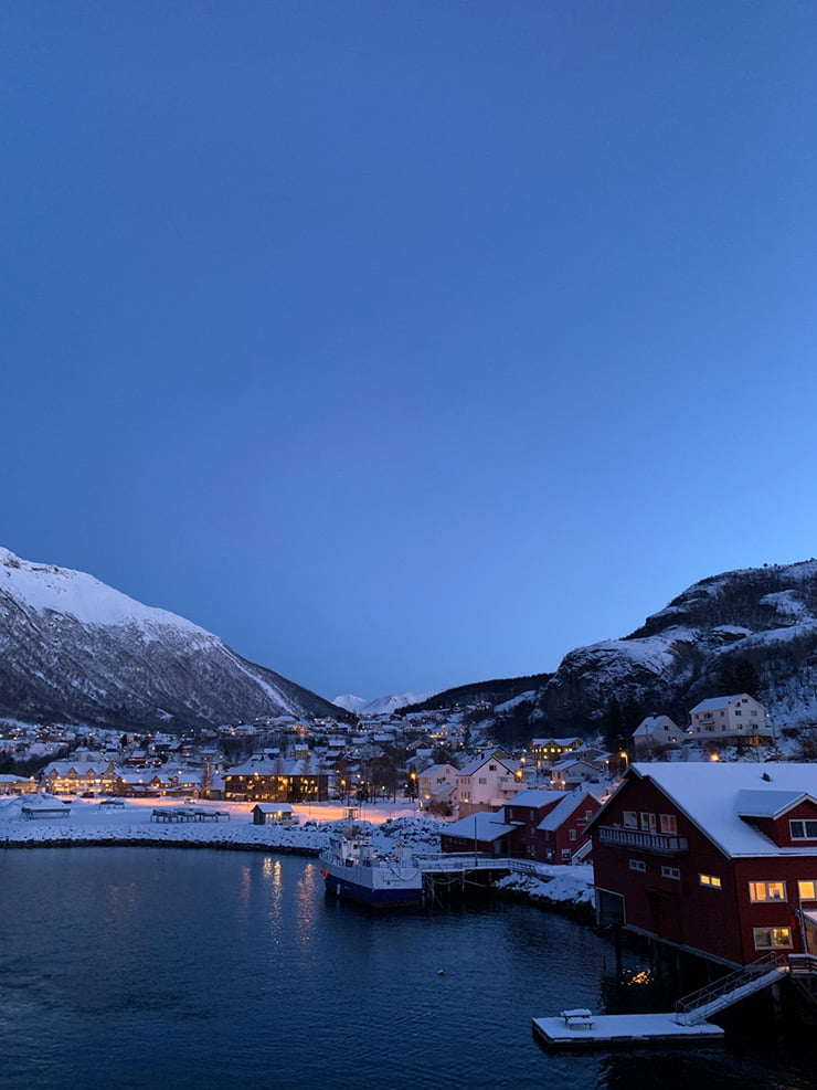 A port stop at Ørnes in Norway during the morning blue hour