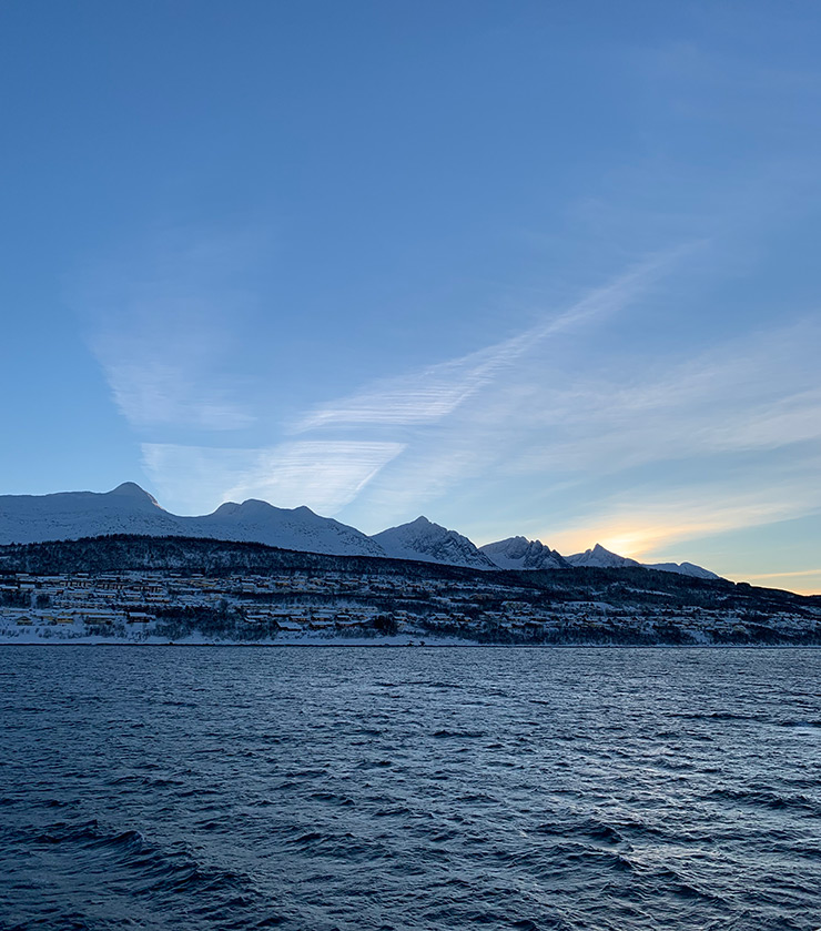 A very late winter sunrise at Norway's Seven Sisters mountains on the Helgeland coast.