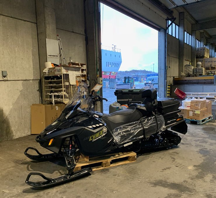 A snowscooter waiting to be loaded on the Hurtigruten as cargo