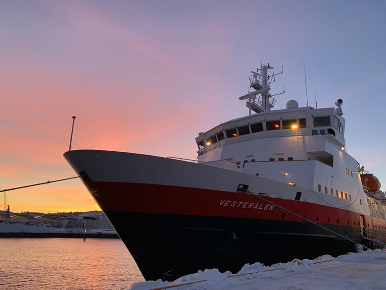 MS Vesterålen in front of a winter Trondheim sunrise