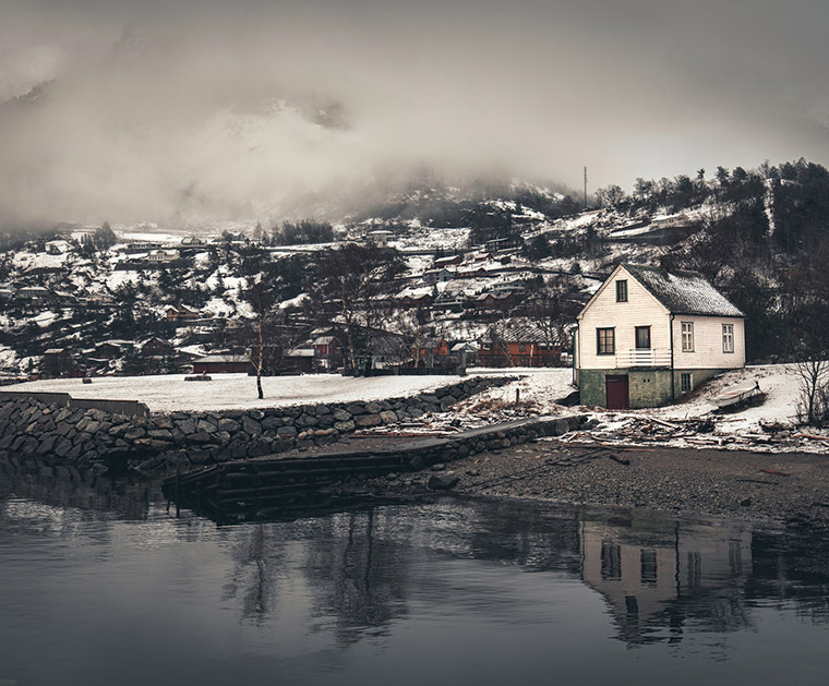 A house and clouds above the Eidfjord, Norway