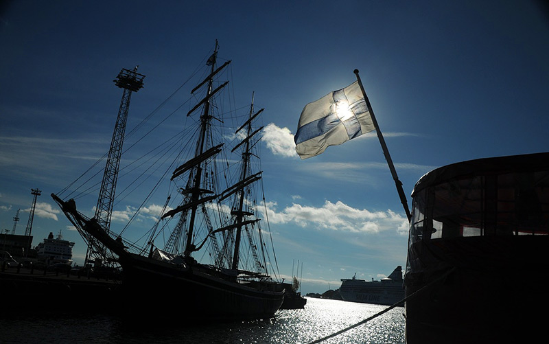 Boat in Helsinki flying the Finnish flag
