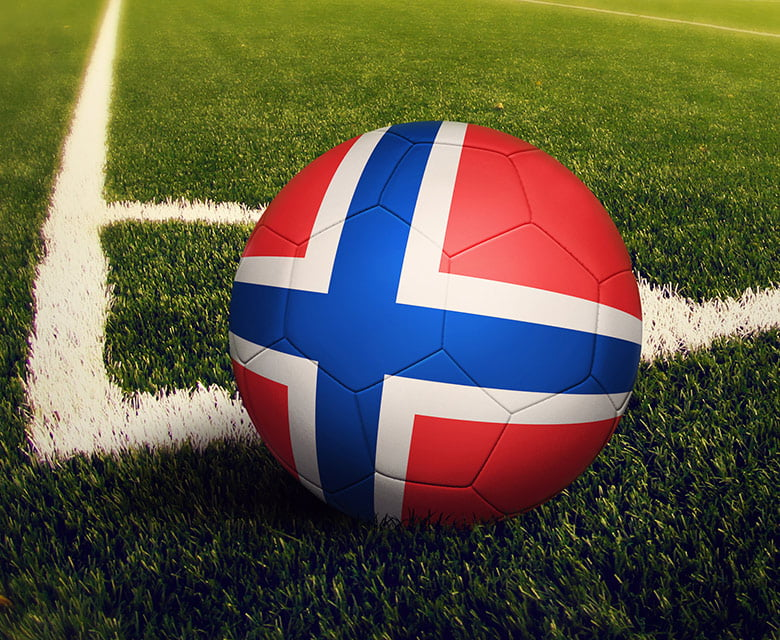 A Norway football at the corner of a pitch