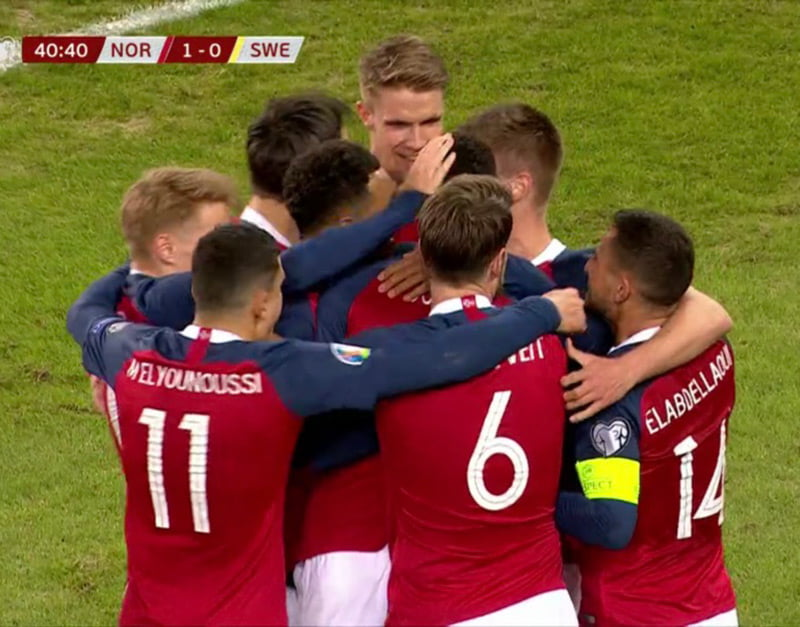 Norway players celebrate the opening goal against Sweden