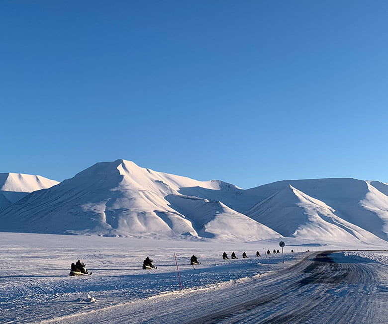 A snow scooter highway next to the road just outside Longyearbyen on Svalbard, Norway