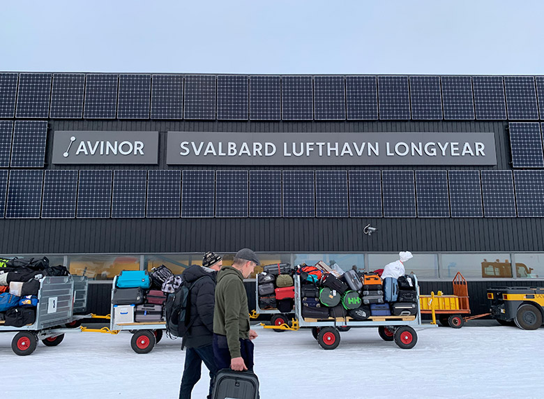 Walking from the plane to the terminal at Svalbard Airport Longyearbyen
