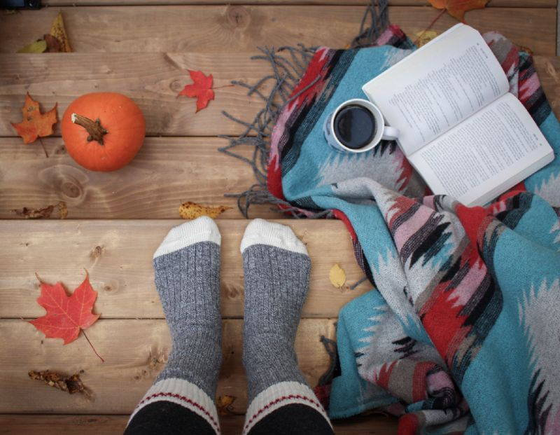 Hygge concept in Denmark, including wool socks, coffee and a book