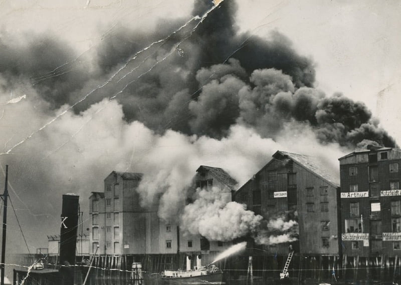 Firefighters tackle a blaze at Albert E. Olsen wharf in Trondheim, Norway