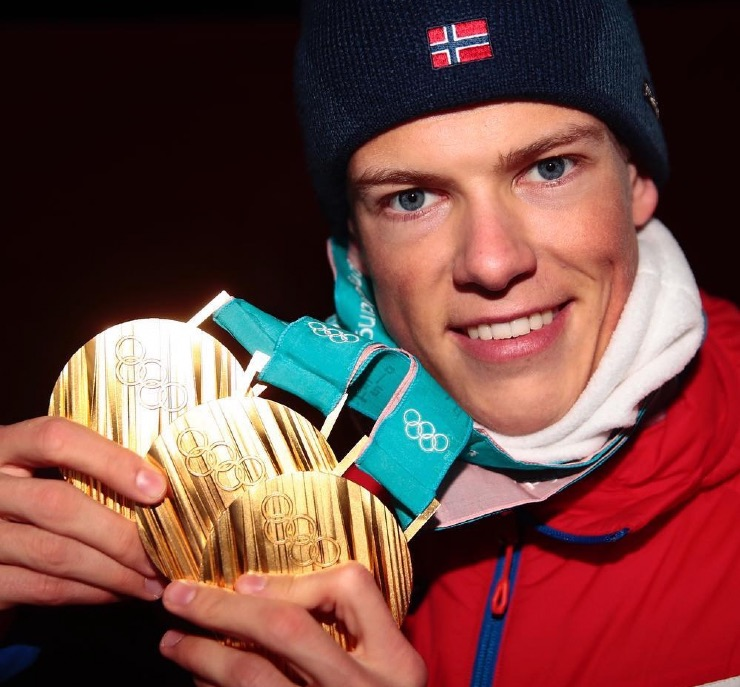 Johannes Klæbo with three Olympic gold medals
