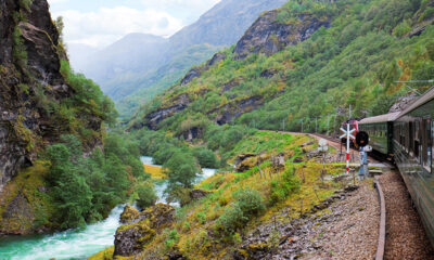 Train on a valley track in Norway
