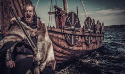 Viking raider with a longship