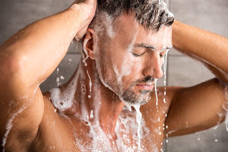 Man in shower in Norway