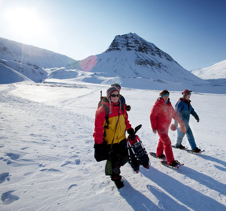 A tour group exploring the landscape of Svalbard