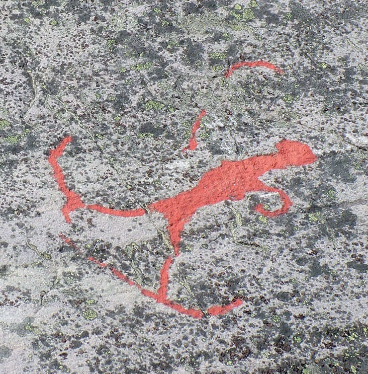 Rock carving showing a skier with bow and arrow in Alta, Norway