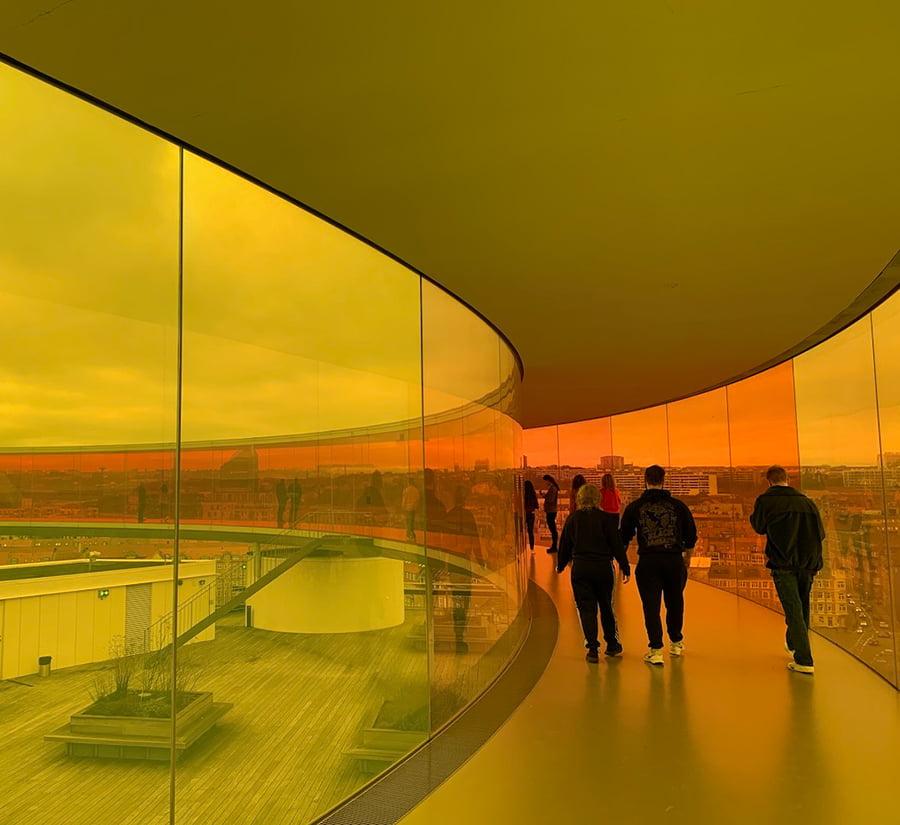 People inside the rainbow panorama skywalk in Aarhus, Denmark