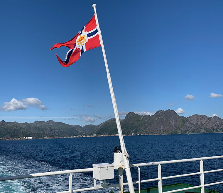 Flag on the back of the MF Røst ferry on route to Skrova