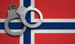Handcuffs on the Norwegian flag