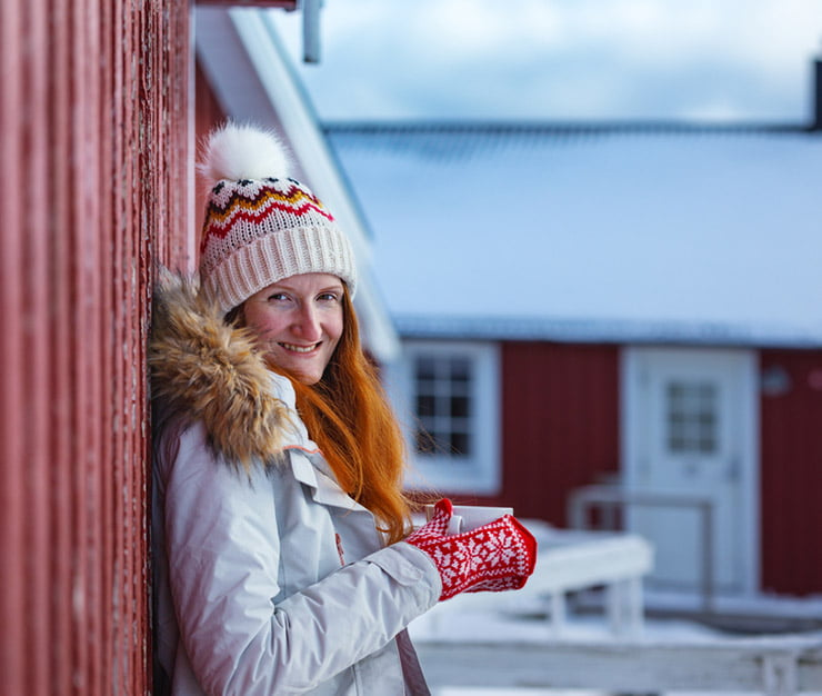 A Norwegian woman wearing knitted hat and mittens