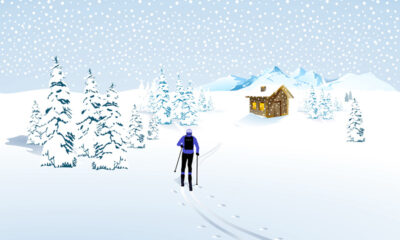 Lone skier by a mountain cabin in Norway