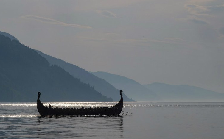 A Viking longship on a fjord in Norway