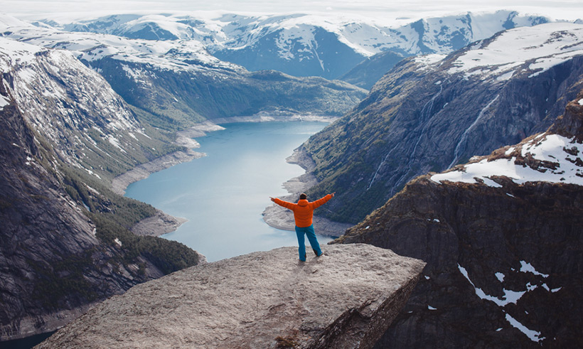 Happy man at Trolltunga in Norway