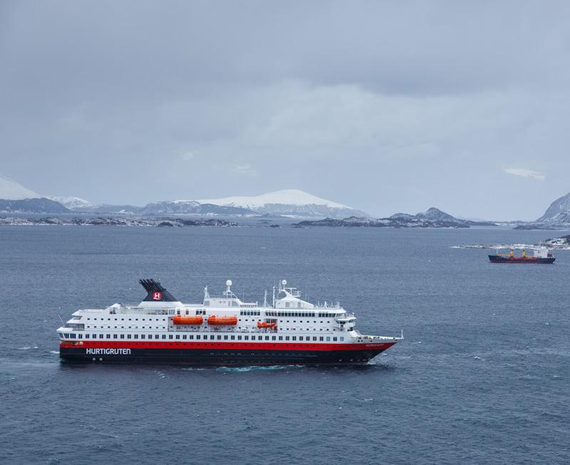 A Hurtigruten vessel on the water during a Norwegian winter