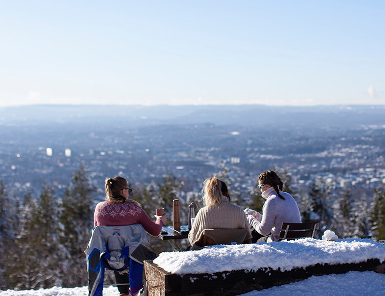 Three girls enjoying the view from Grefsenkollen in Oslo