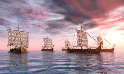 Historical Viking ships full of seafaring Norsemen
