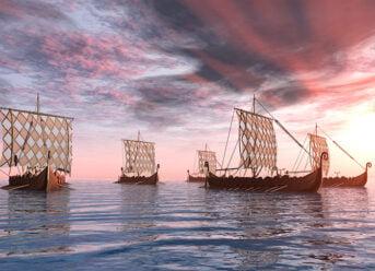 Historical Viking ships full of seafaring Norsemen