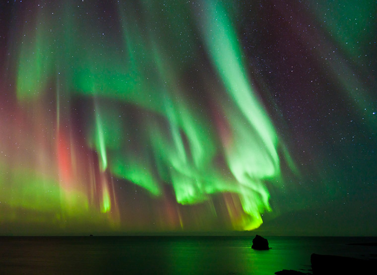 Ribbons of northern lights in the sky in Norway